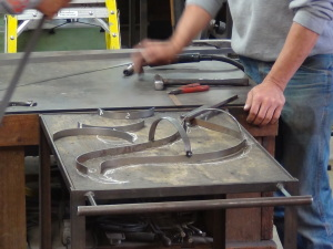 Forming the body with light gauge metal.