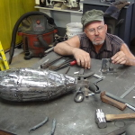 Tom working on his veining tool-. In the foreground you can see the body is taking shape