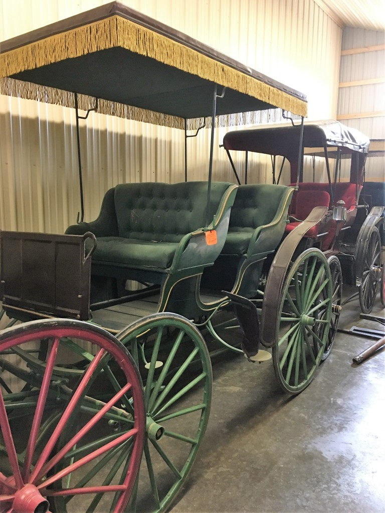 Collection of carriages at Green County Horseshoe Supply Inc.