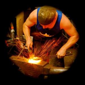 Dan Corkery welding a barshoe at a practice. Photo credit: Rachael Brassard.