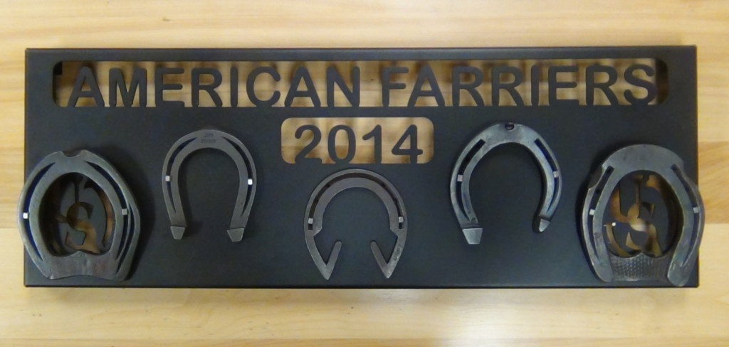 A close-up of the American Farrier's Team Plaque